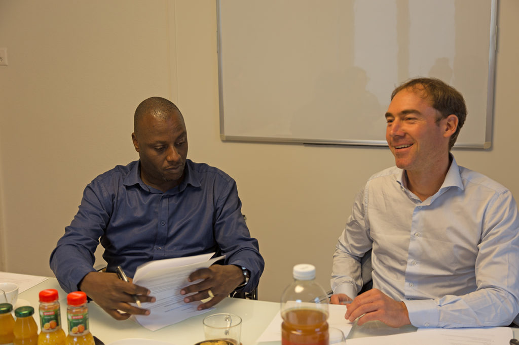 Andrew Kambugu & Jan Fehr signing the statutes